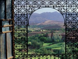 View through Ornate Iron Grille (Moucharabieh), Morocco by Merrill Images