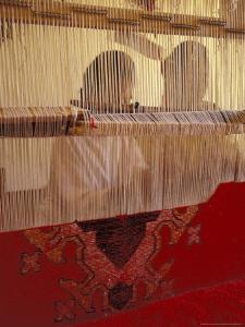 Women Knotting Berber Carpet on Loom, Morocco by Merrill Images