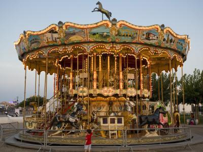 https://imgc.artprintimages.com/img/print/merry-go-round-at-saintes-maries-de-la-mer_u-l-pd5rss0.jpg?p=0