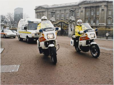 Metropolitan Police Motorcyclists Esccorting an Ambulance Past Buckingham Palace in London--Photographic Print