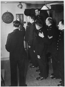 Metropolitan Police Officers Relaxing Playing a Game of Darts