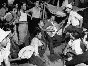 Mexican Farm Workers Singing in their Bunkhouse