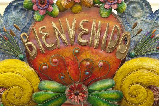 Mexico, San Miguel De Allende. a Colorful Metal Sign Saying 'Welcome' Is Sold in a Market-Brenda Tharp-Photographic Print