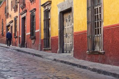 Mexico, San Miguel de Allende. Elderly man walks up sidewalk.-Don Paulson-Photographic Print