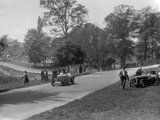 MG J2 passing the crashed Austin 7 of B Sparrow, Donington Park Race Meeting, Leicestershire, 1933-Bill Brunell-Photographic Print