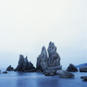 Dramatically Shaped Sea Stacks in Ocean by Micha Pawlitzki