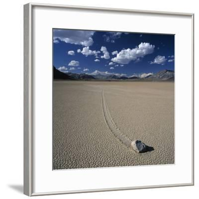 Rock Pushed by Wind in Desert