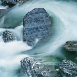 Rushing water and rocks on South Island, New Zealand by Micha Pawlitzki