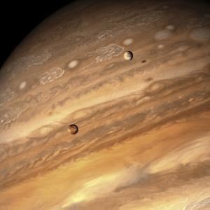 Io and Europa over Jupiter by Michael Benson