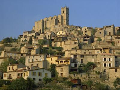 Christian Church on the Skyline and Houses in the Village of Eus, Languedoc Roussillon, France