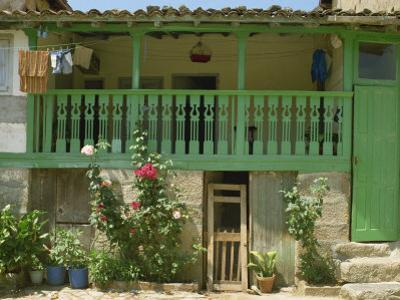 Detail of the Exterior of a House with a Green Door and Woodwork, Arenas De San Pedro, Spain
