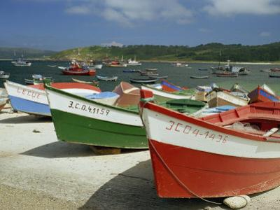 Fishing Boats on the Beach and in the Harbour of the Village of Muxia in Galicia, Spain, Europe