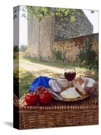 Picnic Lunch of Bread, Cheese, Tomatoes and Red Wine on a Hamper in the Dordogne, France