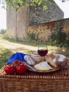 Picnic Lunch of Bread, Cheese, Tomatoes and Red Wine on a Hamper in the Dordogne, France by Michael Busselle