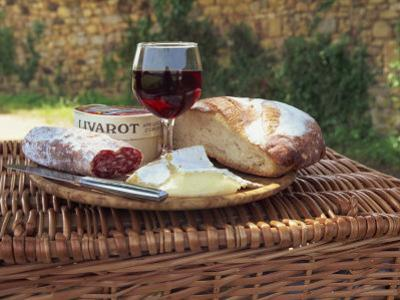 Still Life of Picnic Lunch on Top of a Wicker Basket, in the Dordogne, France