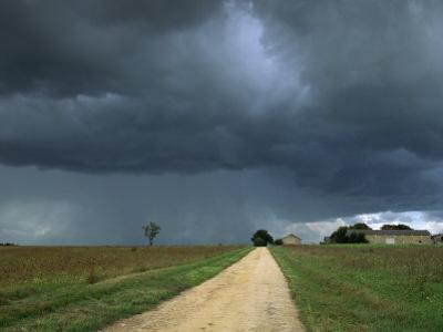 Straight Rural Dirt Road Through Farmland Near Le Mans, Sarthe in Loire, Centre, France
