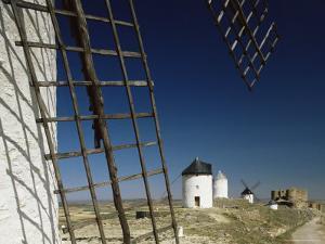Windmills and Castle, Consuegra, Toledo, Castile La Mancha, Spain by Michael Busselle