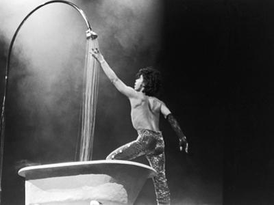 Prince,E Simulates a Shower During Concert Performance, 1984 by Michael Cheers