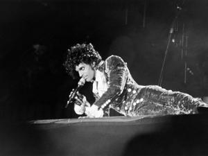 Prince, Lying on Stage During His Purple Rain Tour, 1984 by Michael Cheers