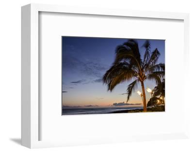 Tiki Torches at Sunset on Poipu Beach, Kauai, Hawaii, United States of America, Pacific