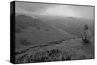 Michael Fay crouches on a mountaintop after nine months in the jungle-Michael Nichols-Stretched Canvas Print