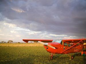The Cessna Makes a Pit Stop to Refuel on the Serengeti, Tanzania by Michael Fay