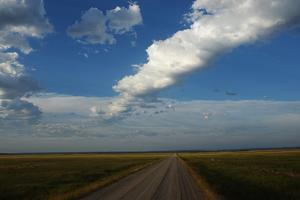 A Rural Gravel Road and Long Strings of Clouds by Michael Forsberg