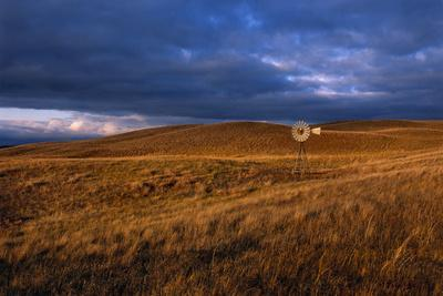 A Solitary Windmill Stands in a Remote Prairie Landscape