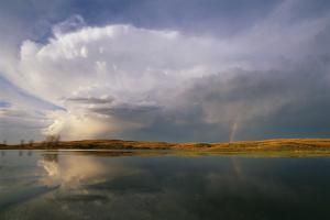 Clouds over a Lake in the Remote Hills of Nebraska by Michael Forsberg
