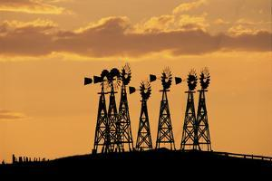 Seven Windmills Stand Tall at Sunset on a Hilltop by Michael Forsberg