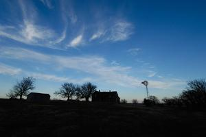 Silhouette of Barns and a Windmill Against Blue Sky by Michael Forsberg