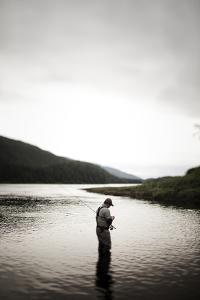 A Man Fly Fishes for Spawning Salmon in a Remote Inlet in Alaska by Michael Hanson