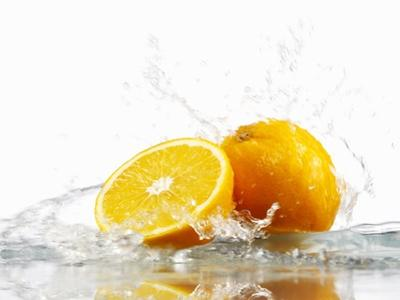 Oranges with Splashing Water by Michael L?ffler