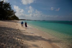 Tourists Walk Down Seven Mile Beach Toward Town by Michael Lewis
