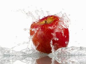Red Apple with Splashing Water by Michael Löffler