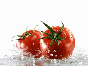 Two Tomatoes Surrounded with Water by Michael Löffler