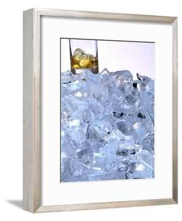 A Whiskey Glass on a Mountain of Ice Cubes
