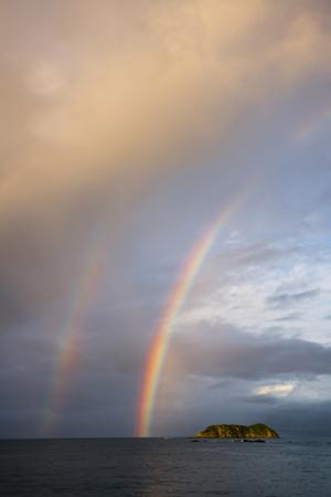 A Double Rainbow over the Pacific Ocean by Michael Melford
