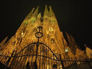 A Night View of Gaudis Temple Expiatori De La Sagrada Familia by Michael Melford