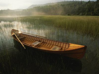 An Adirondack Guide Canoe Floating on Connery Pond at Sunrise