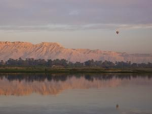 At Sunrise, Hot Air Balloons Hover Above the Nile by Michael Melford