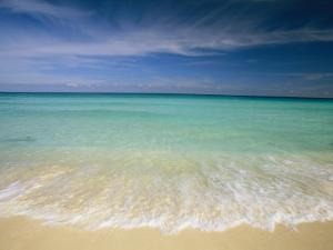 Clear Blue Water and Wispy Clouds Along the Beach at Cancun by Michael Melford