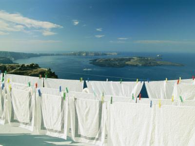 Laundry Hanging Out To Dry with a Scenic Hilltop View of the Water by Michael Melford