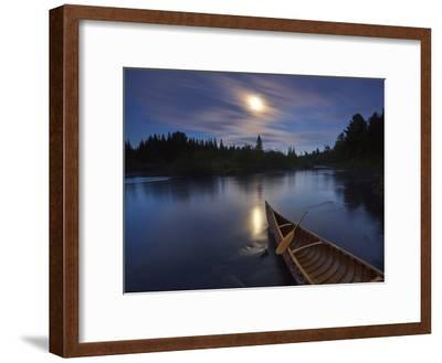 Moonlight Bathes a Birchbark Canoe on Maine's Allagash River