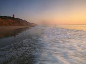 Nauset Light on the Shoreline of Nauset Beach by Michael Melford