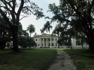 Old Antebellum Style Mansion Amid Palm Trees and Live Oaks by Michael Melford