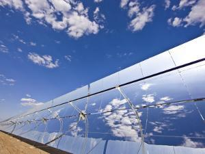 Parobolic Mirrors at a Solar Thermal Plant are Used to Heat Oil by Michael Melford