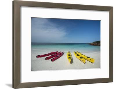 Sea Kayaks Resting on the Beach on Isla Iguana