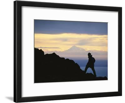 Silhouette of Hiker Ascending Flat Top Mountain at Sunset