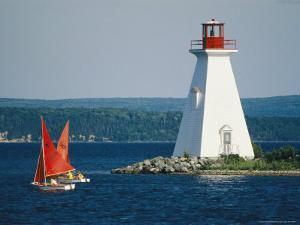 Small Sailboats Racing Past a Lighthouse by Michael Melford